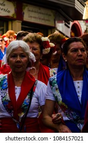 NERJA, SPAIN - MAY 04, 2018 people participating in a traditional folk dance in the street, typical Spanish costumes