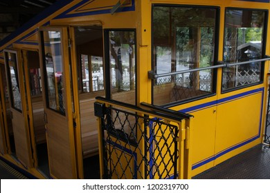 Nerobergbahn funicular Wiesbaden, a small train going up to the Neroberg with the Russian Orthodox Church of Wiesbaden, Germany. Line opened in 1888, and is one of few funiculars with water propulsion