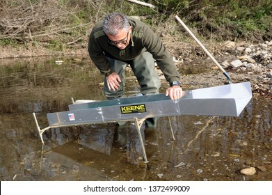 NERS, FRANCE - NOVEMBER 19, 2016: Gold researcher with his sluice in the French River Le Gardon in the Cevennes region