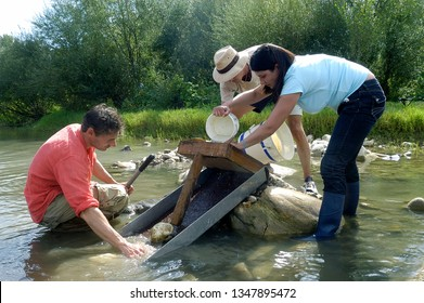 NERS, FRANCE - SEPTEMBER 20, 2009: Group of French gold diggers at work in the river Gardon Cevennes in the Gard department