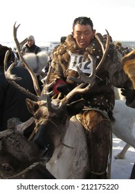 NERUNGRI, RUSSIA - MARCH 4: Racing on deer during the celebration of the reindeer herder in Yakutia on March 4, 2006 in Nerungri.