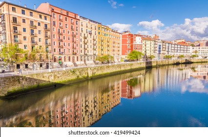 The Nervion river crosses the center of the city of Bilbao, Basque Country, Spain, having at its margin houses, churses, bars, etc.