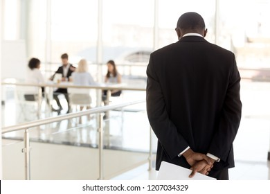 Nervous African American employee standing in hallway waiting to enter business meeting, worried black presenter anxious about making presentation for colleagues or workers in boardroom