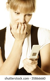 Nervous blonde businesswoman biting fingers looks to phone screen