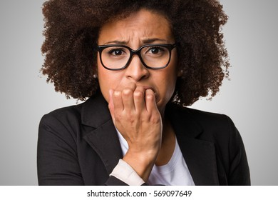 nervous business black woman on a grey background
