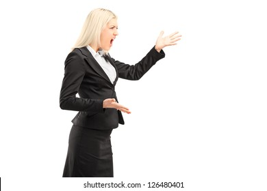 A nervous businesswoman shouting isolated on white background