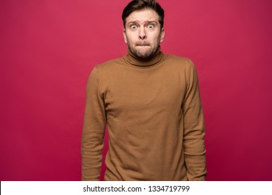 Nervous embarassed man, looks worried before visiting doctor or dentist. Anxious concerned male student feels anxiety before passing course or diploma paper, afraid of difficult questions