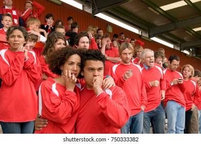 Nervous fans at football match