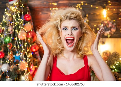 Nervous, thrilled and scared emotions. Merry Christmas and happy new year. Surprised woman. Crazy comical face. Comic grimace