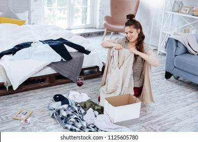 Nervous woman. Angry nervous woman feeling hysterical while tearing clothes of husband after treason