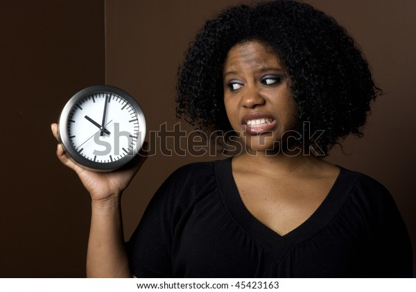 Nervous Woman looking at clock