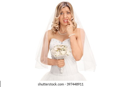 Nervous young bride biting her nails and looking at the camera isolated on white background