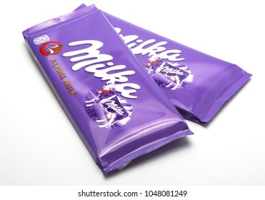 Nes, Holland– DECEMBER 19, 2017: Bar of Milka chocolate isolated on white. Milka is a brand of chocolate confection which originated in Switzerland in 1901.