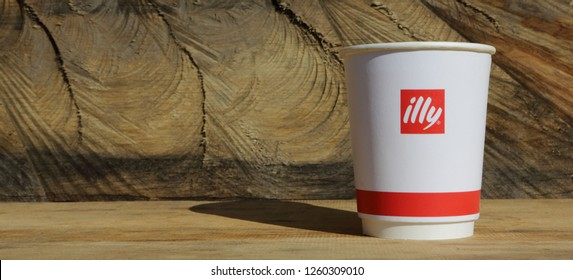 Nes, Holland - FEB 8, 2018: Paper cup of Illy coffee, brand of Italian coffee roasting company that specializes in the production of espresso. Founded by Francesco Illy in 1933. - Ima