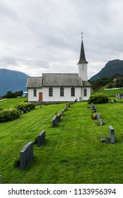 Nes kyrkje, Commune Luster, Norway. White wooden church and churchyard