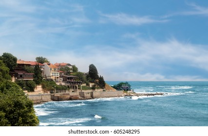 NESEBAR,BULGARIA - MAY30,2016: Seafront view with houses and taverns of the city of Nesebar. UNESCO World Heritage Site and  a famous destination for tourists.