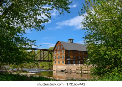 Neshanic Station, New Jersey, USA, May 14, 2020 - The Ammerman Mill on sunny spring day along the Raritan River.