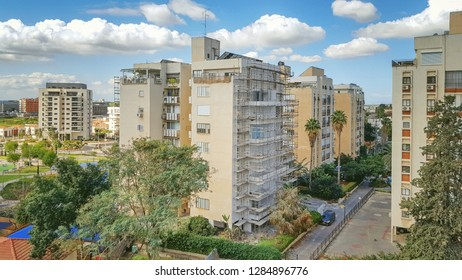 Ness Ziona, Israel-March 11, 2018: Renovation of the old 8-story residential building by mounting sun balconies in both sides.
