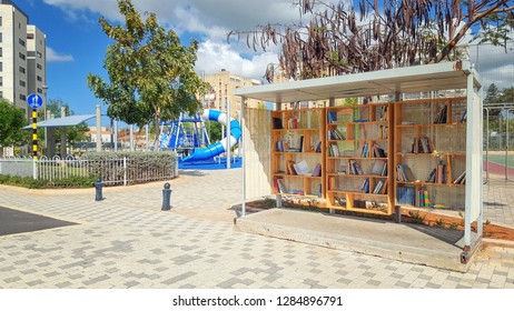 Ness Ziona, Israel-March 11, 2018: Open air extemporaneous voluntary library arranged by the dwellers of the neighborhood in the former bus stop sun shelter. The picture was taken in Hoshen street.