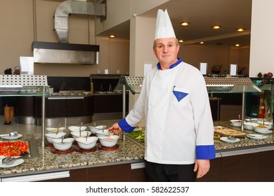 NESSEBAR, BULGARIA - AUG 26: The chef of the restaurant of hotel poses in the workplace in hotel Marvel, Nessebar, Bulgaria at August 26, 2016