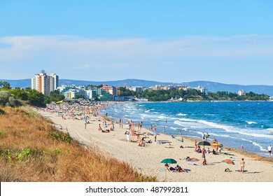 NESSEBAR, BULGARIA - AUGUST 17, 2016: People on Beach on the Black Sea with a view of the old town of Nessebar, Bulgaria