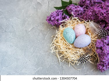 Nest with  easter eggs and spring lilac flowers
