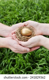 Nest egg in couple's hands