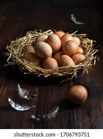 Nest of fresh dirty eggs in a basket