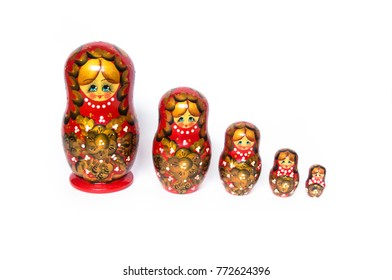 Nested dolls are arranged in a row on a white background. Top view of nested dolls