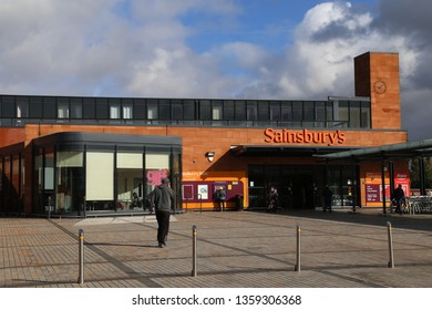 Neston, Cheshire, England, UK.  March 9, 2019.  A Sainsbury's supermarket and shopping plaza in the centre of town.