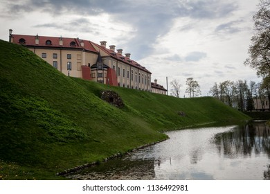 Nesvizh, Belarus - 05/06/2017: View to Nesvizh Castle surrounded by water graff
