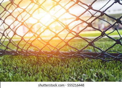 The net in Artificial turf at sunset.