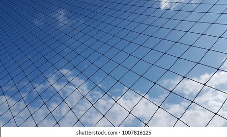 Net to catch balls around a football field , on clear sky background.