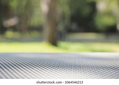 net metal table background with tree and nature background