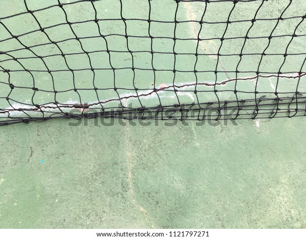 Net on green cement floor texture