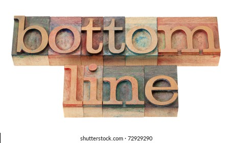 net profit or loss concept - bottom line words in vintage wooden letterpress printing blocks, stained by color inks, isolated on white
