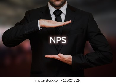 Net Promoter score (NPS) concept text between hands of the businessman, blurry bokeh background