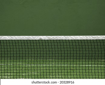 Net of tennis court on green wall background.