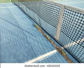 The net of a tenniscourt in the morning light