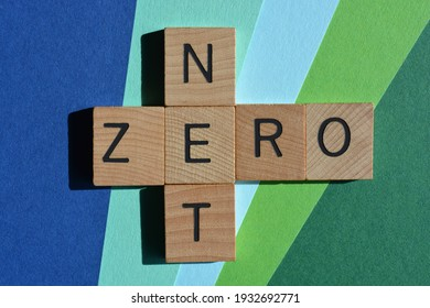 Net Zero, words in wooden alphabet letters in crossword form isolated on green and blue background