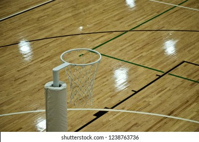 Netball Hoop. An indoor court on wooden floorboards. The Netball Hoop is viewed from above showing the Goal Third Line Markings.