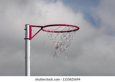 Netball post  against a blue sky.