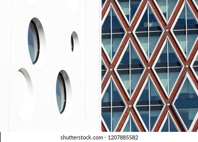 NETHERLANDS - 12 OCTOBER, 2018: Modern Dutch Architecture: Detail of the cinema inspired by Gouda Cheese and the town hall of the municipality of Gouda inspired by Stroopwafels or Syrup waffles.