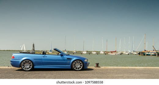 Netherlands 20 May, 2018, BMW M3 e46 convertible standing outdoors at the IJsselmeer on a sunny day.