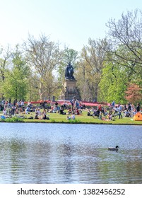Netherlands, Amsterdam, 20 April 2019 : People In Vondelpark On A Sunny Day