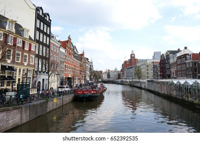Netherlands, Amsterdam city and river, April 2016, people are walking the city