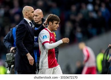 NETHERLANDS, Amsterdam - January 21th 2018: Ajax speler Nico Tagliafico during the Ajax - Feyenoord match got the thank you from head coach Erik ten Hag (l)