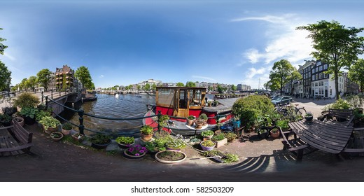 Netherlands, Amsterdam - May 2014: Full 360 equirectangular equidistant spherical panorama view of street of Amsterdam. Virtual reality content