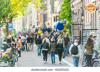 NETHERLANDS, AMSTERDAM - OCTOBER 2: people walking on the street of Amsterdam on October 2, 2015