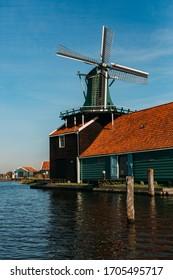 NETHERLANDS, AMSTERDAM - OCTOBER 9, 2018: Zaanse Schans is a neighbourhood of Zaandam, near Zaandijk, Netherlands. It is best known for its collection of well-preserved historic windmills and houses.